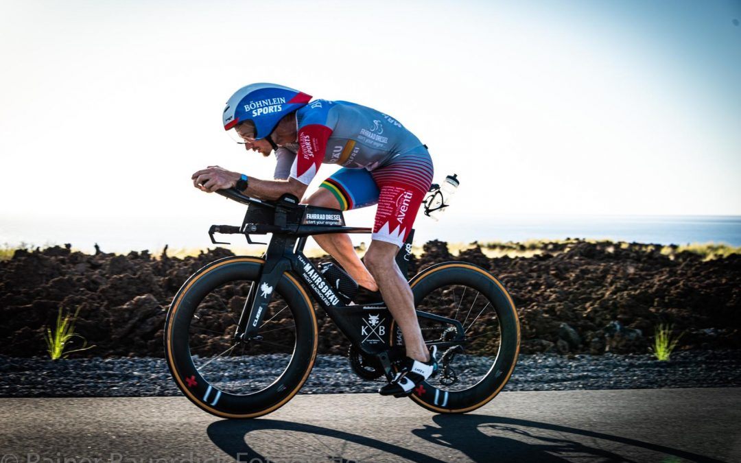 Project Podium Success – Chris Dels stands on the Ironman Podium